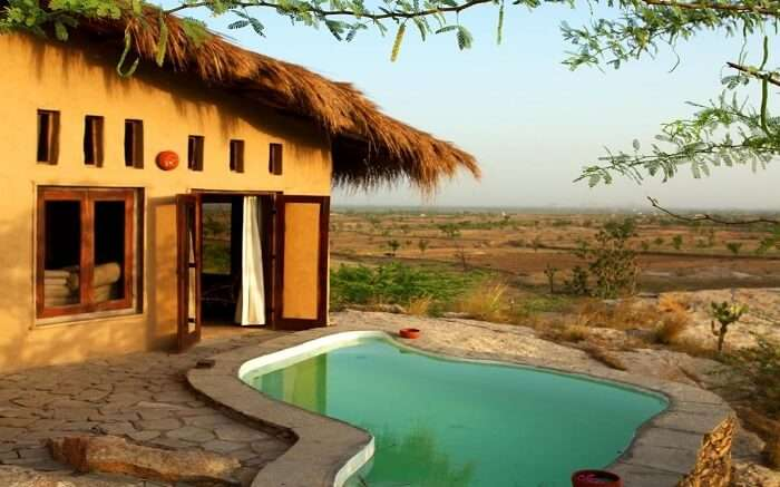 View of private pool with cottage in Lakshman Resort