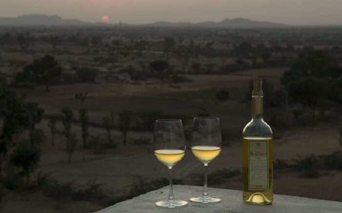 Wine glasses and bottle in Lakshman Sagar Resort