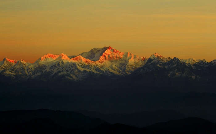 The breathtaking sunrise over the horizon of Khangchendzonga