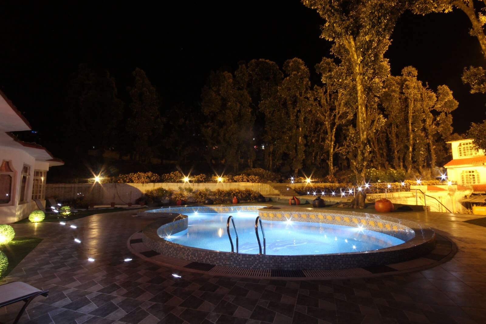 a swimming pool glowing at night
