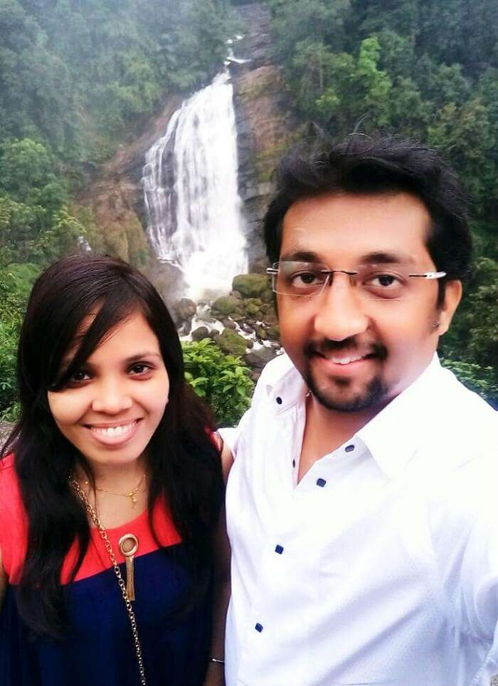 Couple near waterfalls in Kerala