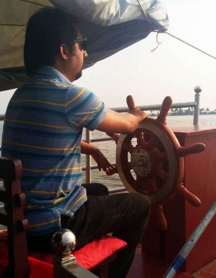 Traveler driving the houseboat