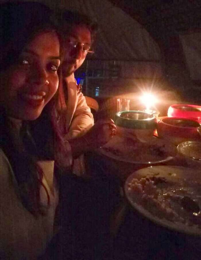 Couple enjoying a candlelight dinner on a houseboat