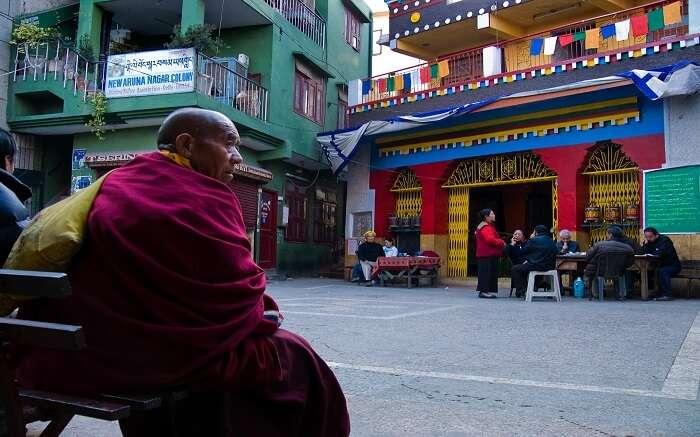 A monk sitting in the monastery complex in Majnu Ka Tila in New Delhi