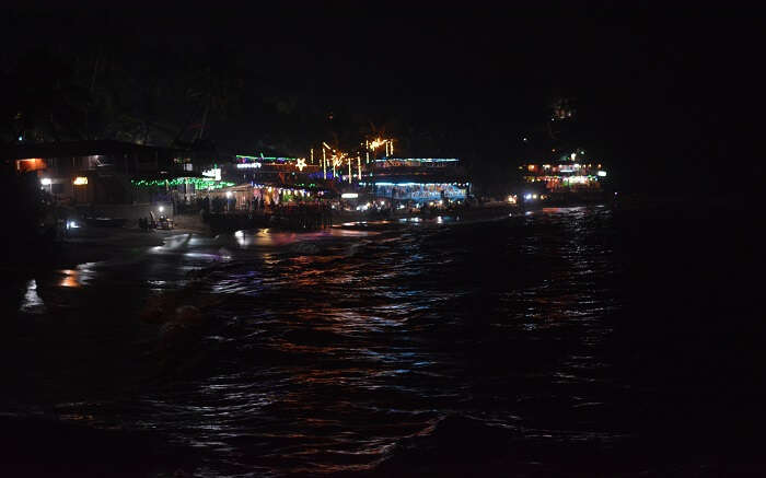 A view of well-lit Curlies at Anjuna Beach in Goa