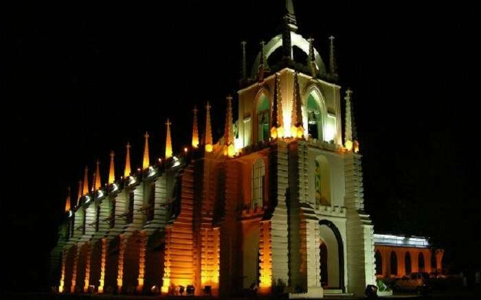 A well-lit church in Goa at night