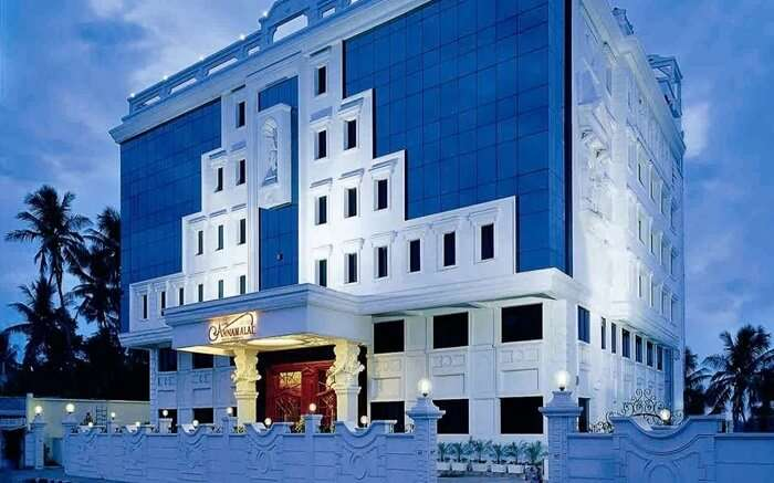 A white and blue beautiful building of Annamalai hotel