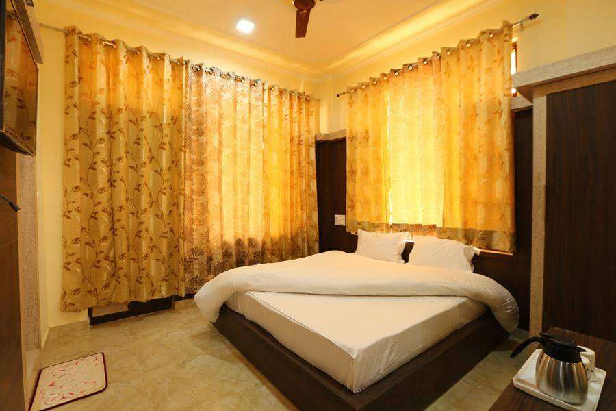 a hotel room with a king size bed