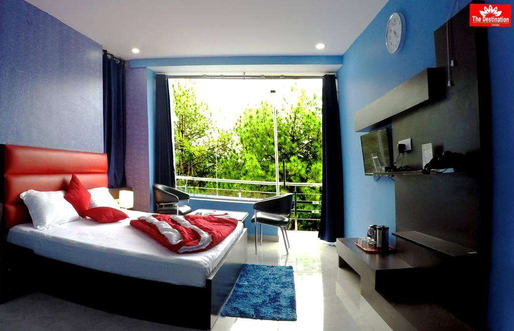 a hotel room with big window