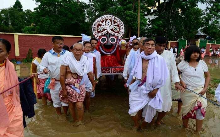 Manipuri people carrying idol of god during festival