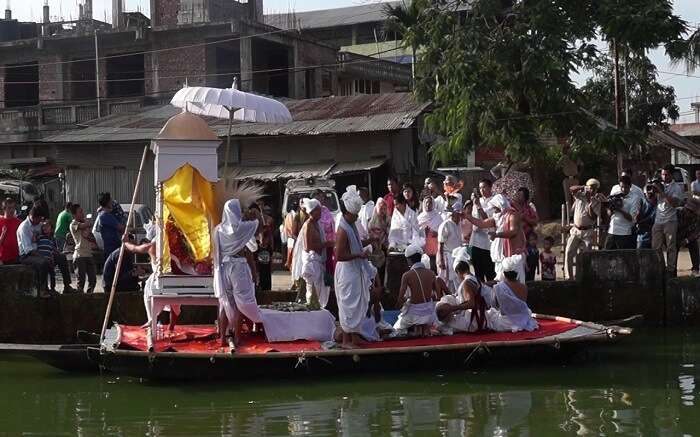 People of Manipur on a boat during a festival