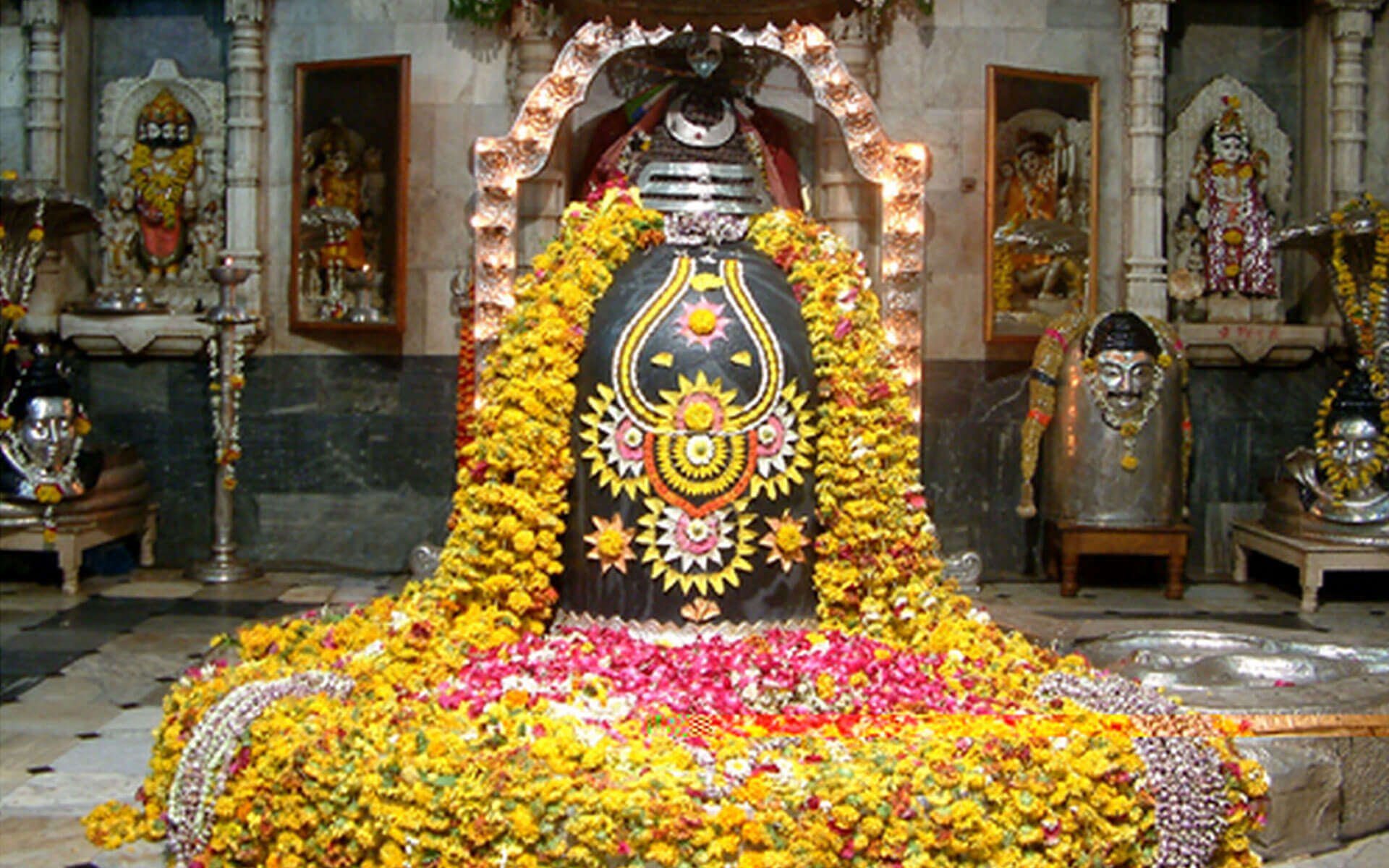 black shivling covered by yellow flowers