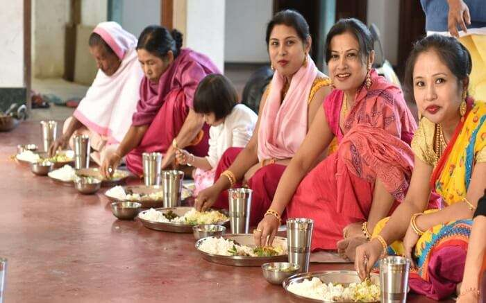 Women of Manipur enjoying a traditional meal during a festival