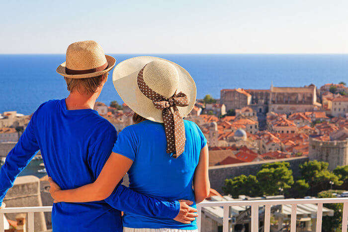 a couple wearing blue clothes enjoying views in a European city