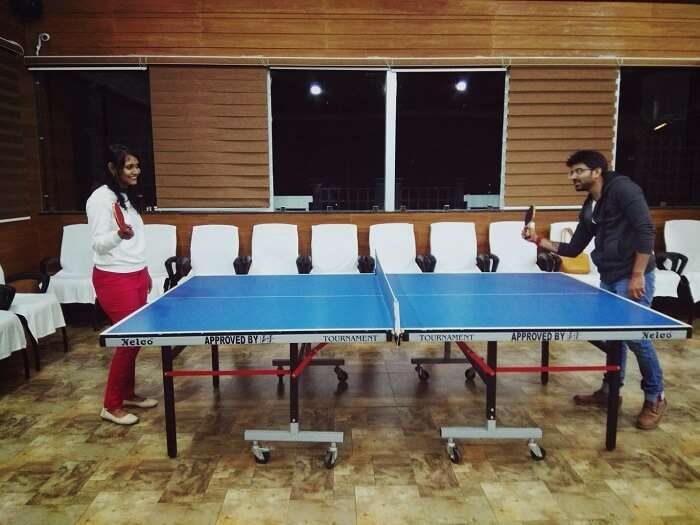 Couple playing table tennis