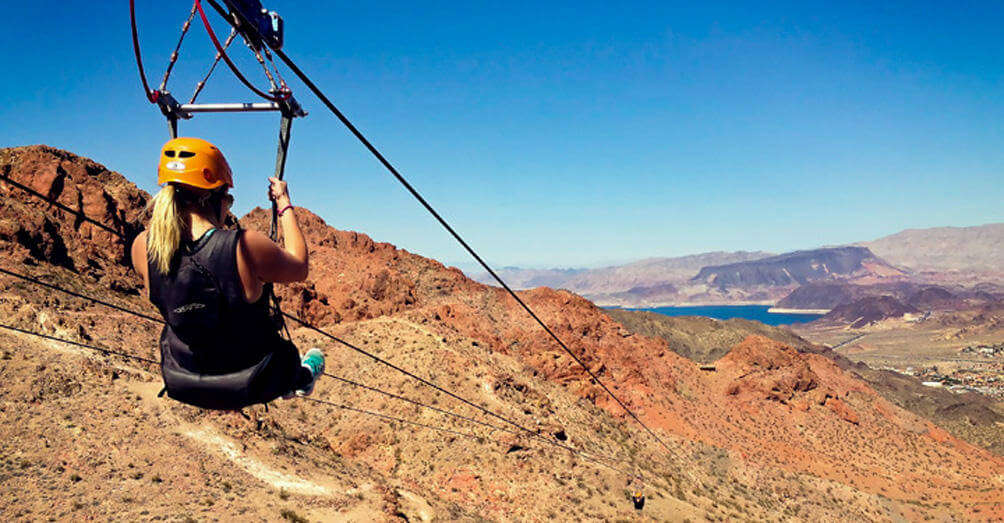 a girl zip lining in grand canyon