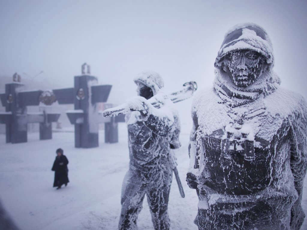 statues covered in snow