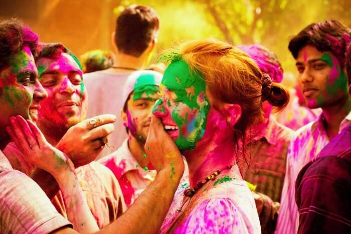 People celebrating during Holi Camping at Dhanu Chiku Farms