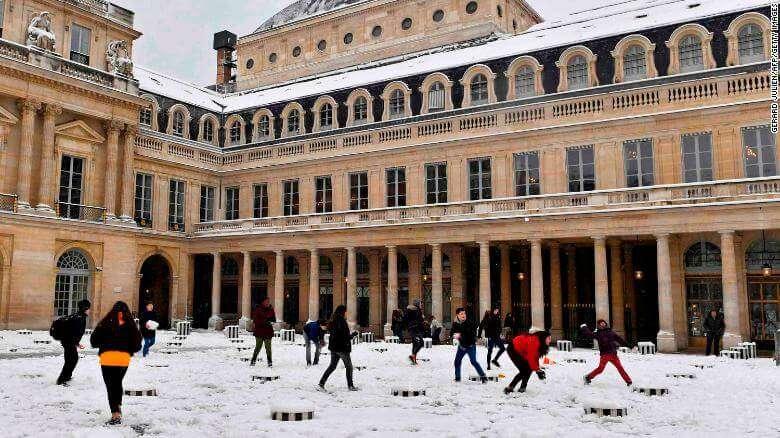 people enjoying snowfall