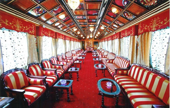 red colour furniture inside a luxurious train