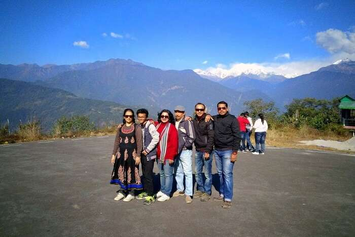 Shantanu northeast trip- whole family posing with snowy hills in the backdrop
