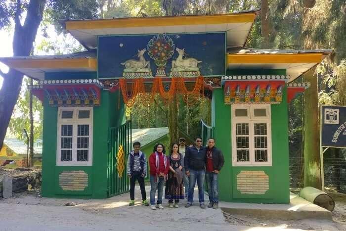 Shantanu northeast trip- posing outside monastery in namchi