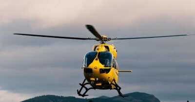 a yellow heli taxi in air