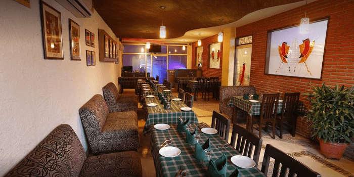 sitting at flavours restaurant Dehradun