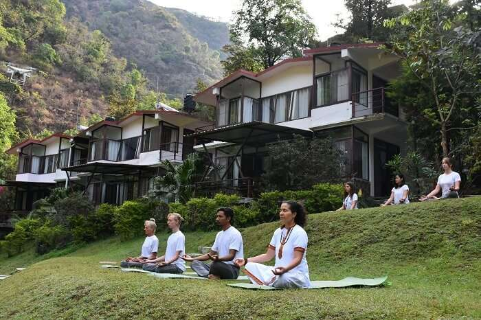 people doing yoga in dhanaulti resort