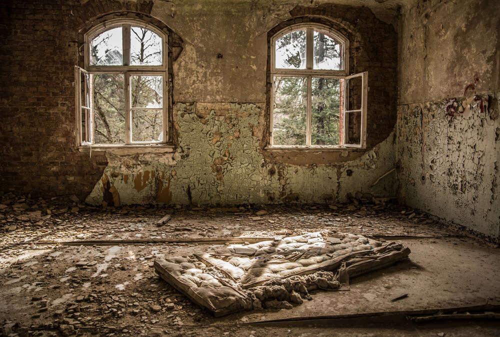 a mattress in an abandoned hospital