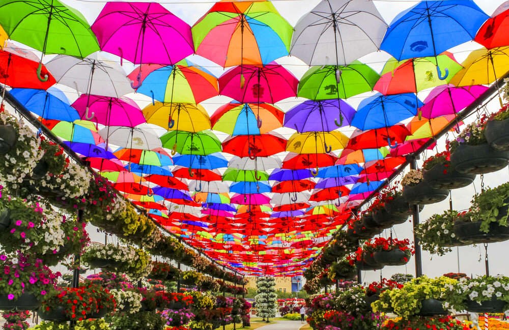 colorful umbrellas hung over street
