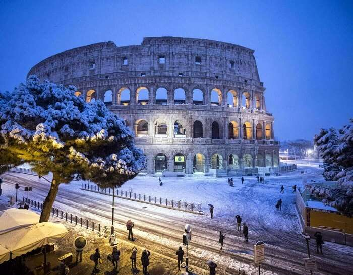 snowfall rome colosseum night