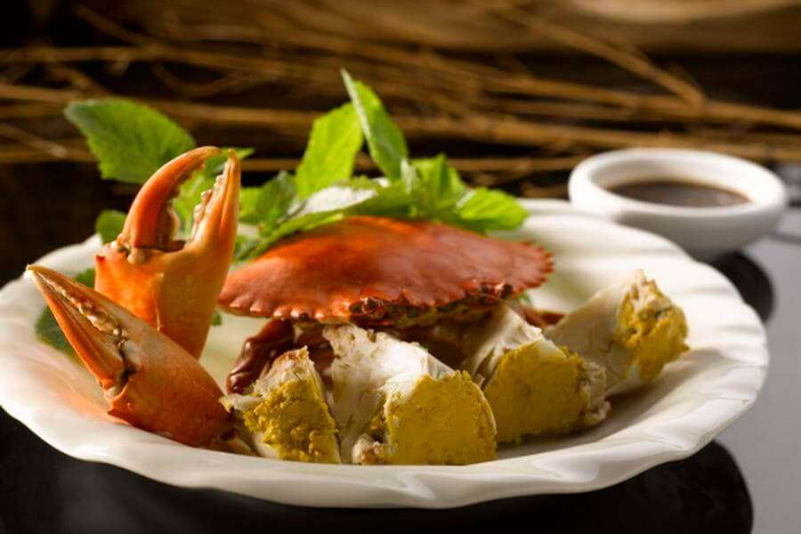 crab dish served on a white plate