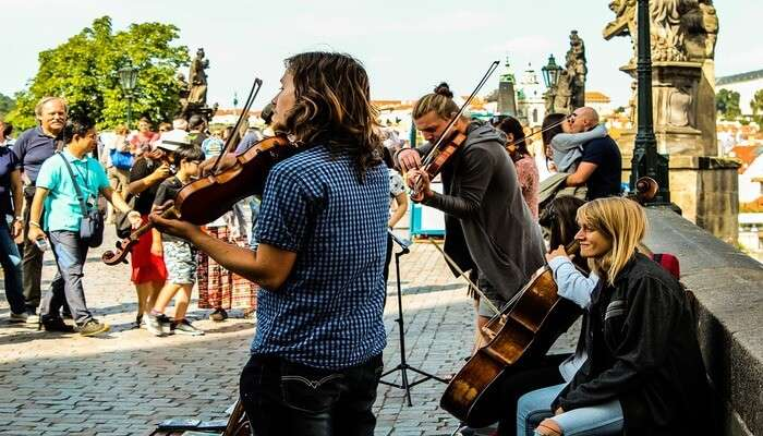 Spot the artists & musicians on the Charles Bridge