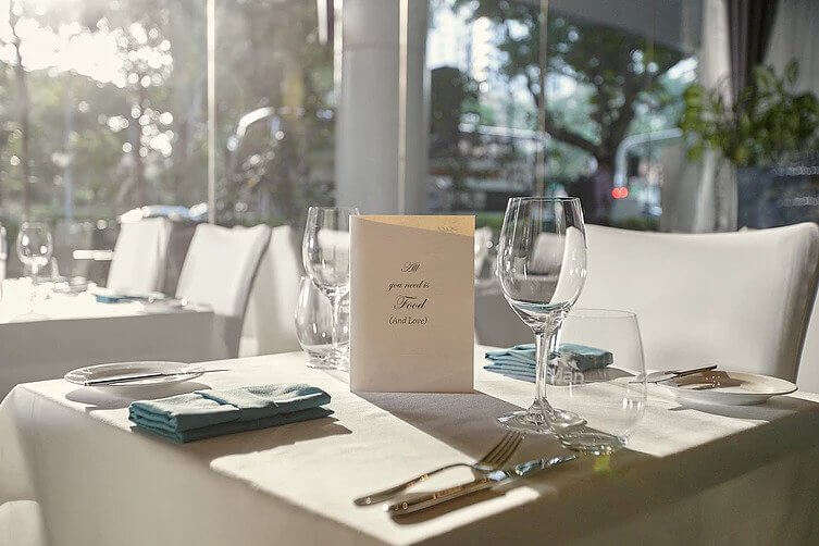 fine dine with empty wine glasses