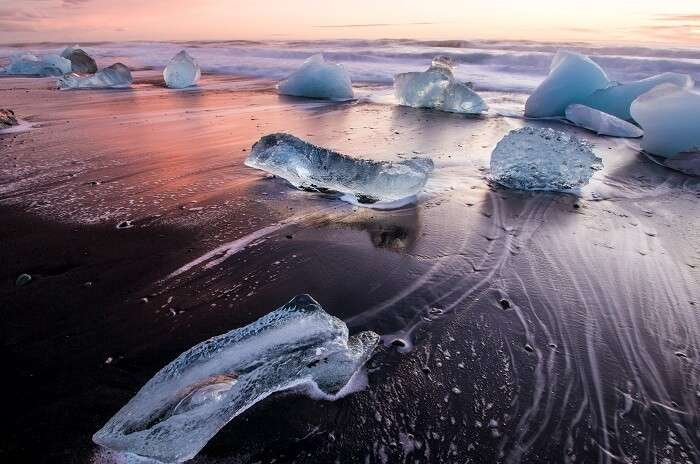 The beaches have black sand, basalt caves...and ICEBERGS