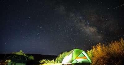 camping under dark sky
