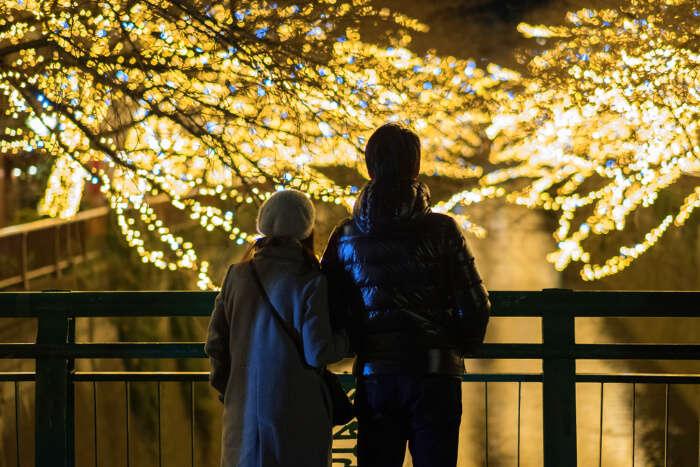 a couple enjoying illumination in tokyo
