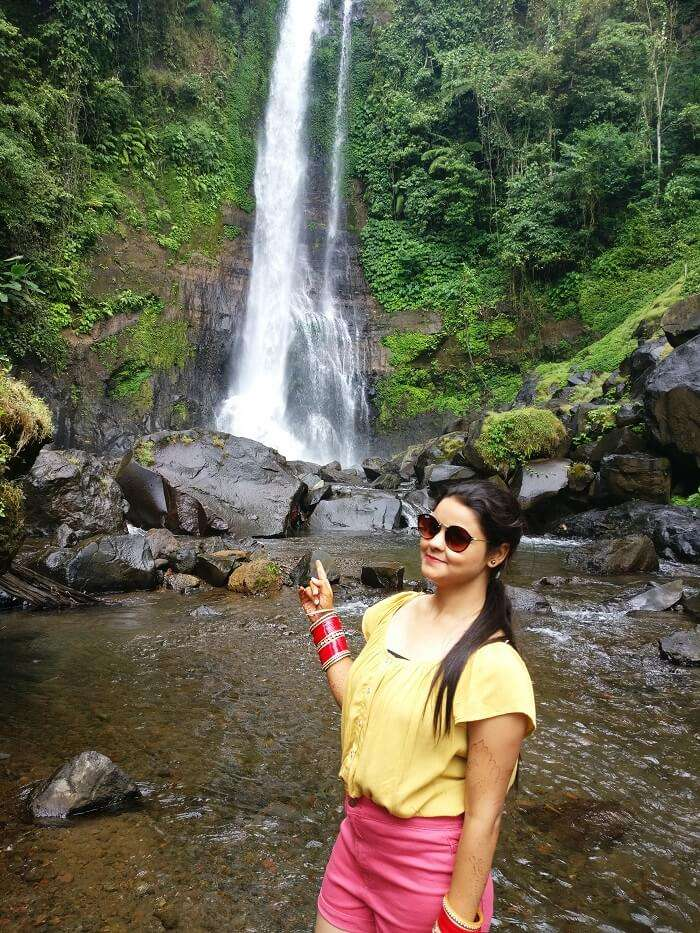 Female traveler at Gitgit waterfalls
