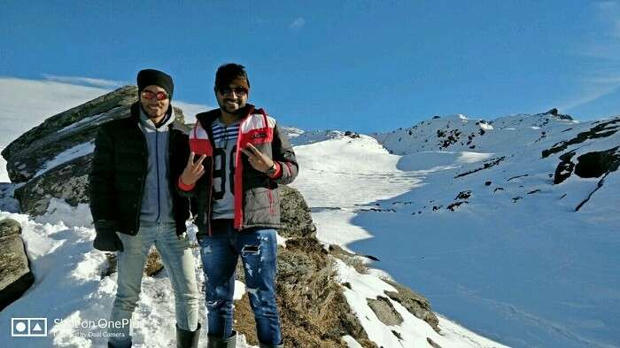 friends on a snowy auli trek