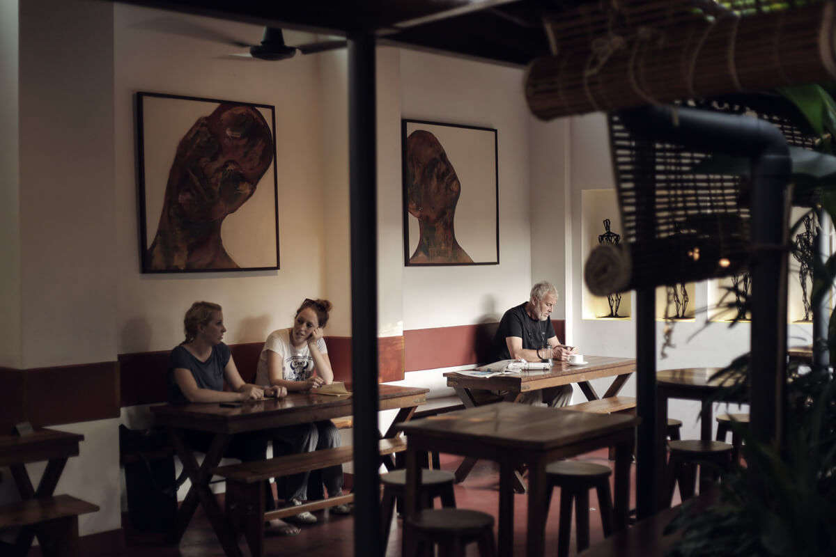 people sitting in an old cafe of Kochi