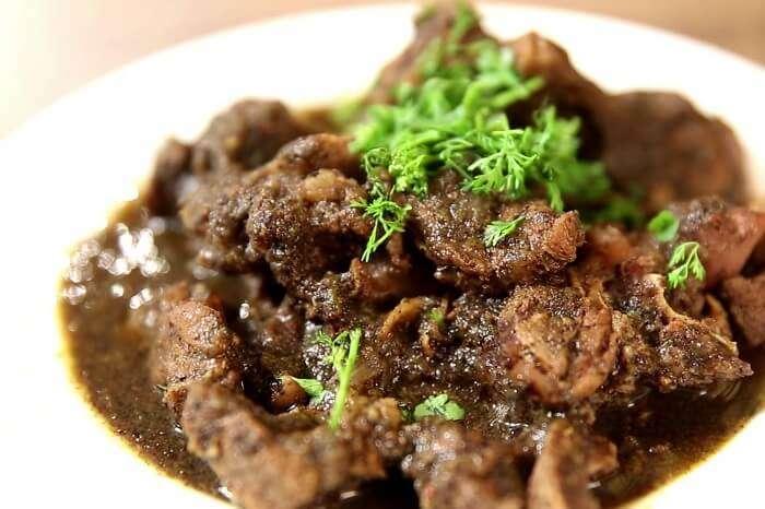 Relish 'pandi curry' and 'akki rotti' coorg