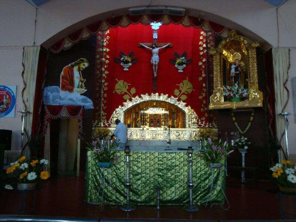 alter of a church decorated with colourful clothes