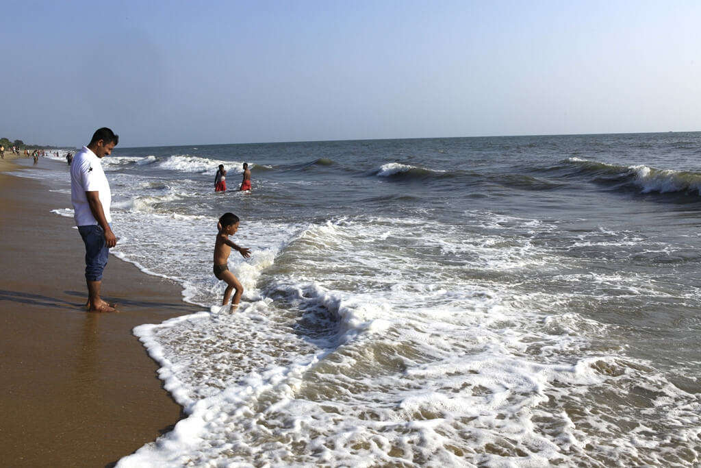 people playing in sea waves