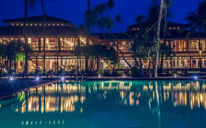 a beautifully lit resort and its reflection on pool water ss30082018