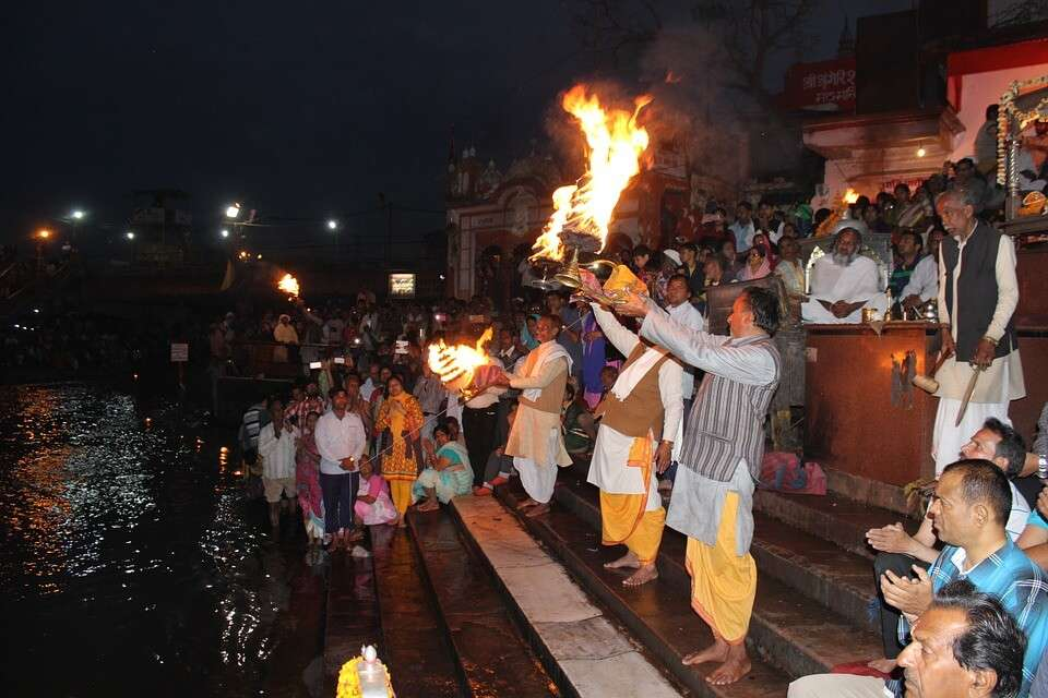 priests doing aarti at the ghat