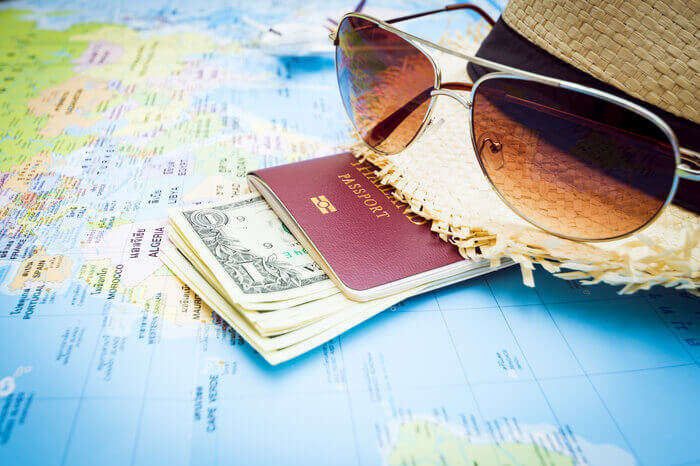 passport and sunglasses with map