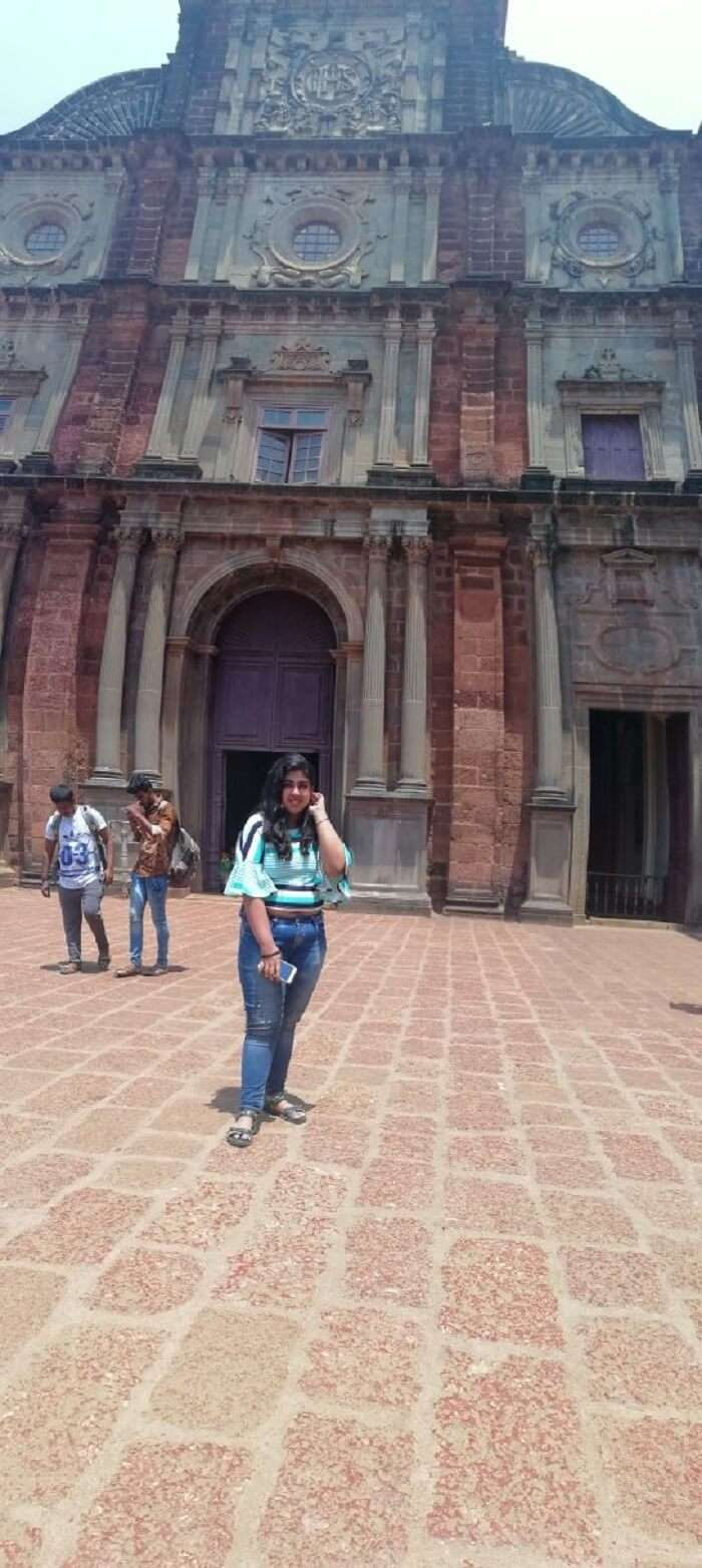 Female traveler at Basilica Bom Jesus Goa