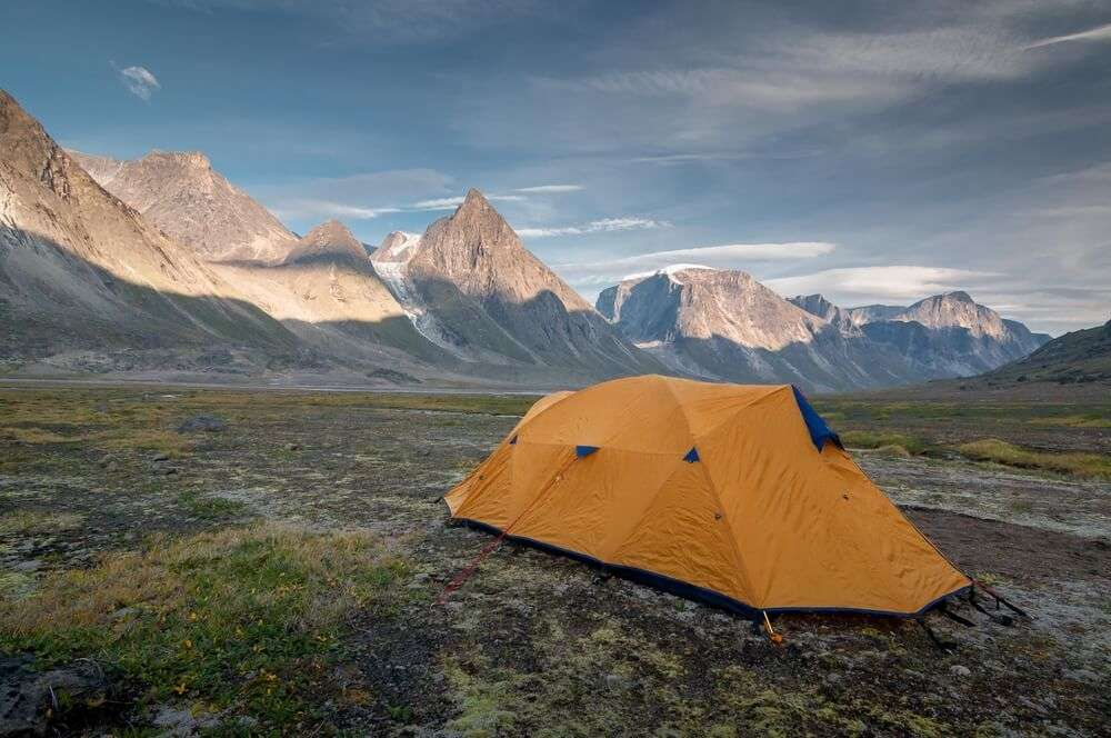 a yellow tent in Auyuittuq National Park