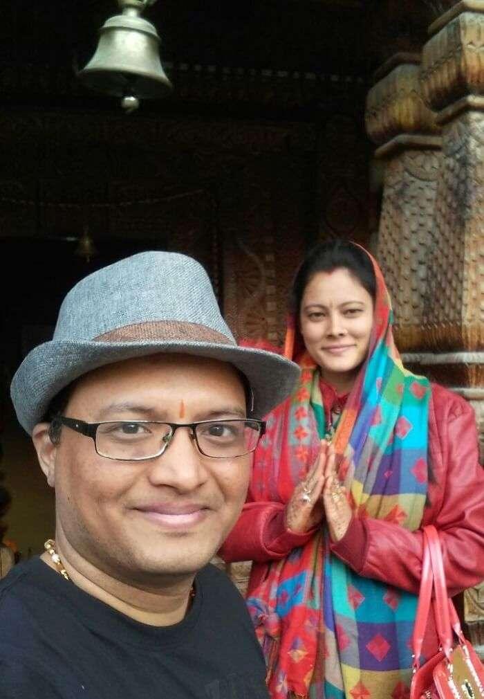 kuldeep manali honeymoon trip: posing near shiv statue manikaran